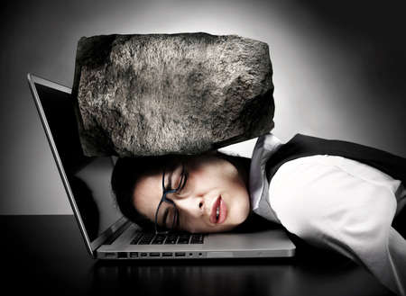 Woman programmer with laptop having stress. Headache. Stock Photo