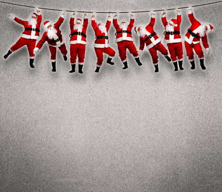 Christmas Santa hanging on rope. Funny concept background. photo