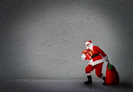 Christmas Santa with a bag. Gifts delivery concept. photo