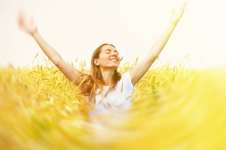 Happy beautiful woman in meadow. Freedom concept background. Stock Photo - 22165591