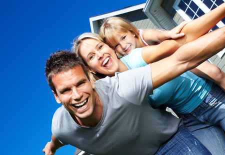 home owner: Happy smiling family with child over  house background
