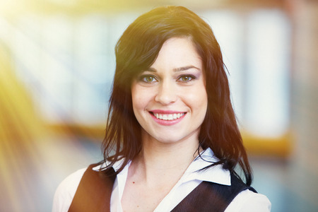 Smiling business woman in the office. photo