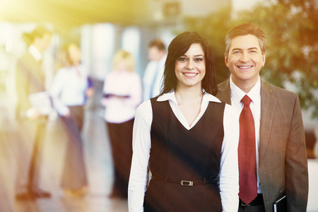 businesswear: Two bussiness partners man and woman over team background