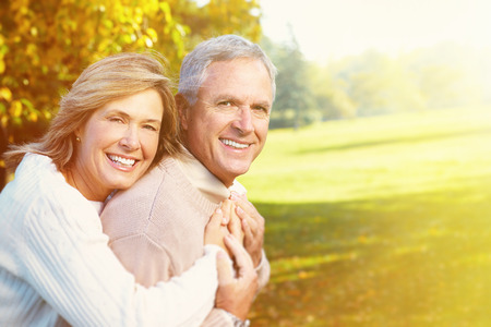 couple having fun: Happy senior couple having fun together in park  Stock Photo