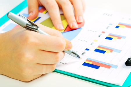 Business people working with graphs. Financial concept. photo