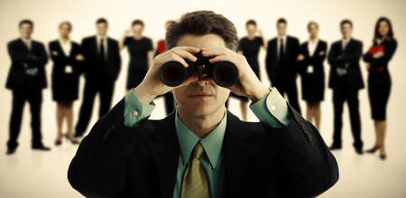 Businessman with binoculars  Job search concept background