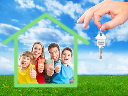 Happy family near new home  Real estate background  photo