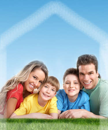 real estate investment: Happy family near new home  Real estate background