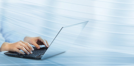 Hands of business woman with laptop computer keyboard. Stock Photo - 22722403