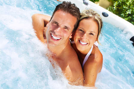 hot tub: Happy couple relaxing in hot tub. Vacation. Stock Photo
