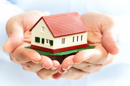 Hands holding Family house model. Real estate background. Stock Photo - 22724230