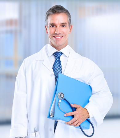 medico: Doctor holding a blue file Stock Photo