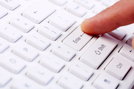 keyboard: Hands of businessman with a computer keyboard. Stock Photo