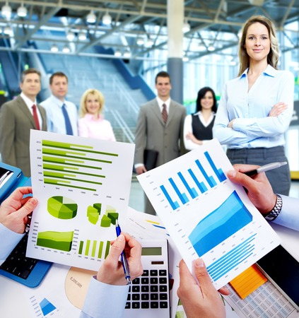 group  accountant: Business people working with graphs. Financial concept.
