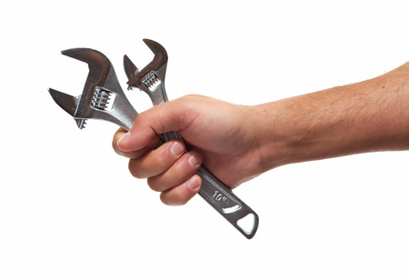 Hand of car mechanic with a wrench. Isolated over white background. Stock Photo