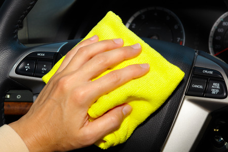 rag wheel: Hand with microfiber cloth cleaning car.
