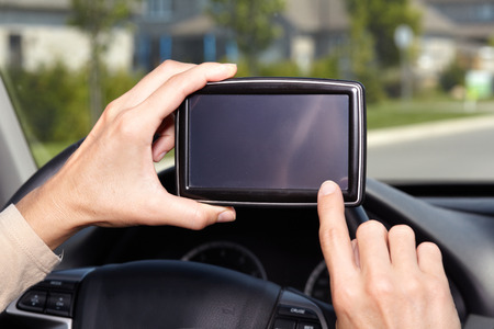 Car driver hands with GPS. Road destination. photo