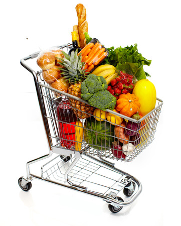 shopping trolley: Full shopping grocery cart. Isolated on white background.
