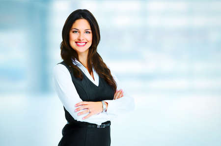 Young bussiness woman standing over office background photo