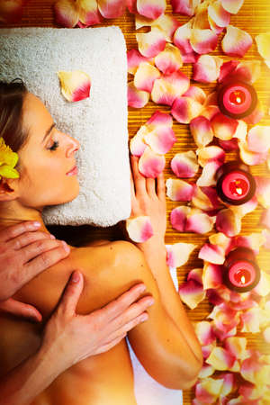 spa candles: Beautiful woman having relaxing in spa massage salon.