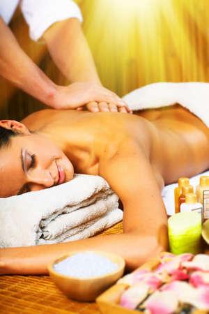 back lighting: Beautiful woman having relaxing in spa massage salon.
