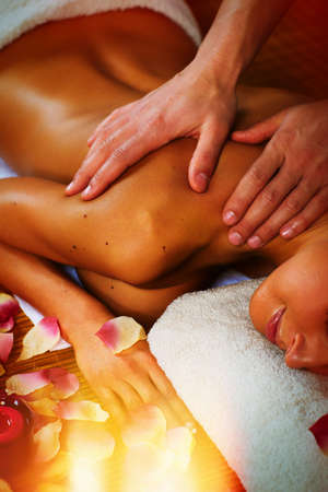 Massage therapy: Beautiful woman having relaxing in spa massage salon.