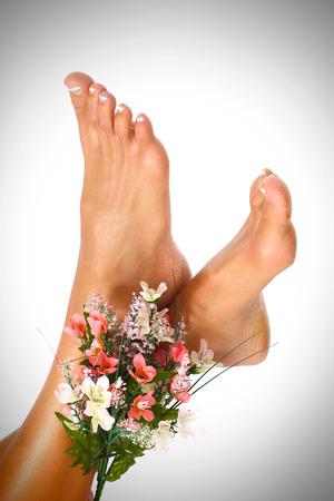 Beautiful woman feet in spa massage salon. Stock Photo - 22724372