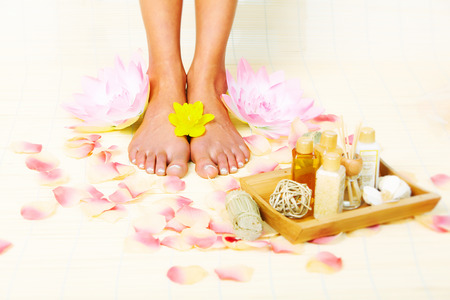 Beautiful woman feet in spa massage salon. Stock Photo - 22724378