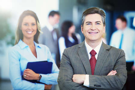 bussiness man: Two bussiness partners man and woman over team background