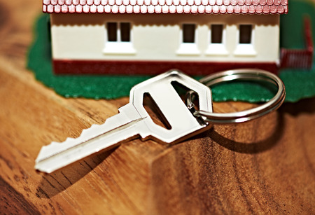 Family house with key. Real estate background. Stock Photo - 22724523
