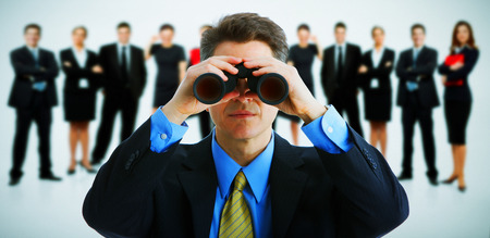 binoculars: Businessman with binoculars. Job search concept background. Stock Photo