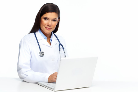 Professional Doctor woman with laptop isolated on white. photo