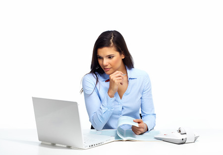 Beautiful business woman working with document in office. photo