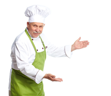 Chef inviting at restaurant. Isolated over white background photo
