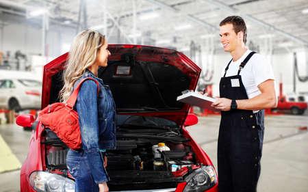 inspecting: Car mechanic in uniform. Auto repair service. Stock Photo