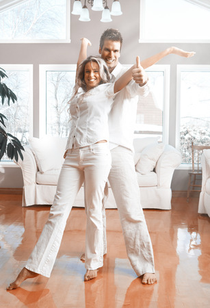 Happy couple at home. Mortgage and insurance concept. photo