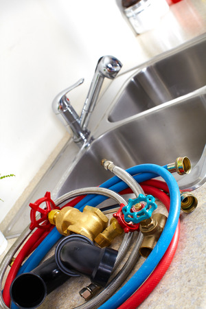 Kitchen sink pipes and drain. Plumbing service. photo