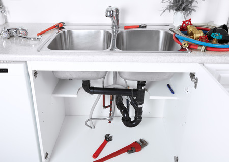 pipe wrench: Kitchen sink pipes and drain. Plumbing service.