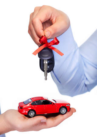 selling service: Car keys. Auto dealership and rental concept background. Stock Photo