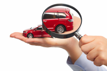 rental: Hand with car. Auto dealership and rental concept background.