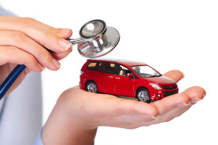 stethoscope: Hand with car. Auto dealership and rental concept background.