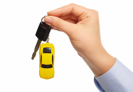 keychain: Car keys. Auto dealership and rental concept background. Stock Photo