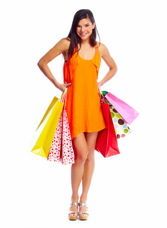 Happy shopping girl with bags. Isolated  white background. photo