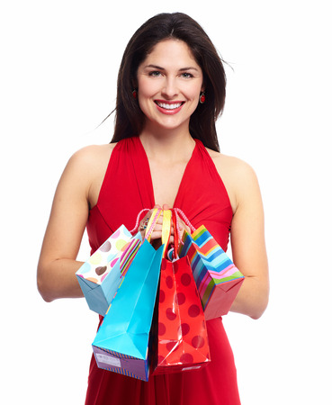 Young happy smiling woman with shopping bags, isolated over white background photo