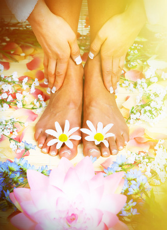 Beautiful woman feet in spa massage salon. Stock Photo - 22770505