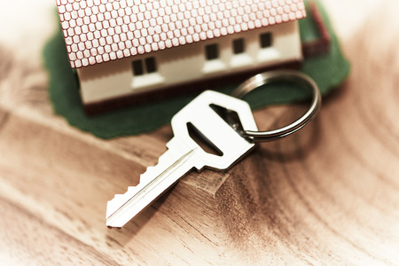 Family house with key. Real estate background. Stock Photo - 22770501