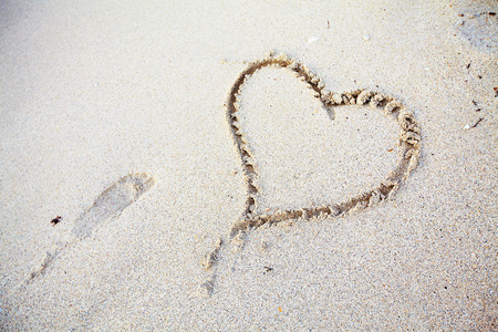 heart in sand: Steps on the beach. Tropical resort.