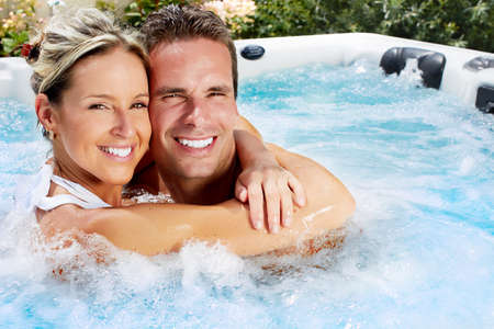 Happy couple relaxing in hot tub. Vacation. Stock Photo