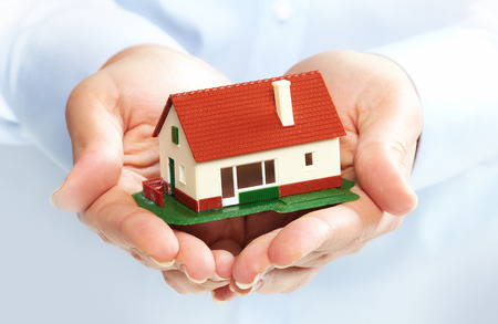 Hands holding Family house model. Real estate background. Stock Photo - 22770422