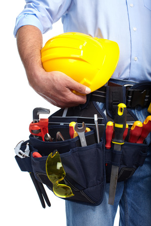 Worker with a tool belt. Isolated over white background. photo